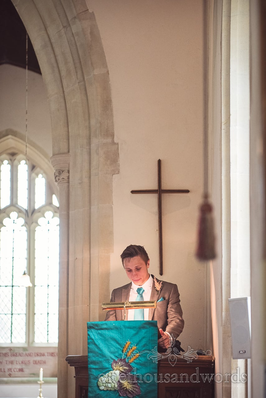 Groomsman delivers reading at Lulworth Castle Wedding Photographs
