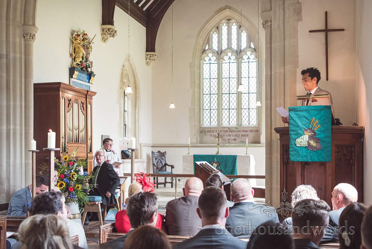 Guests delivers reading in church at Lulworth Castle Wedding Photographs