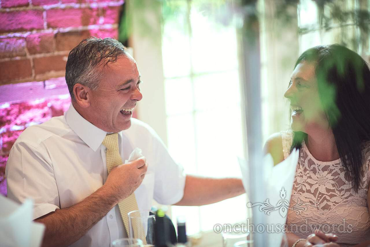 Guests laughing during wedding breakfast at Highcliffe Castle Wedding in Dorset