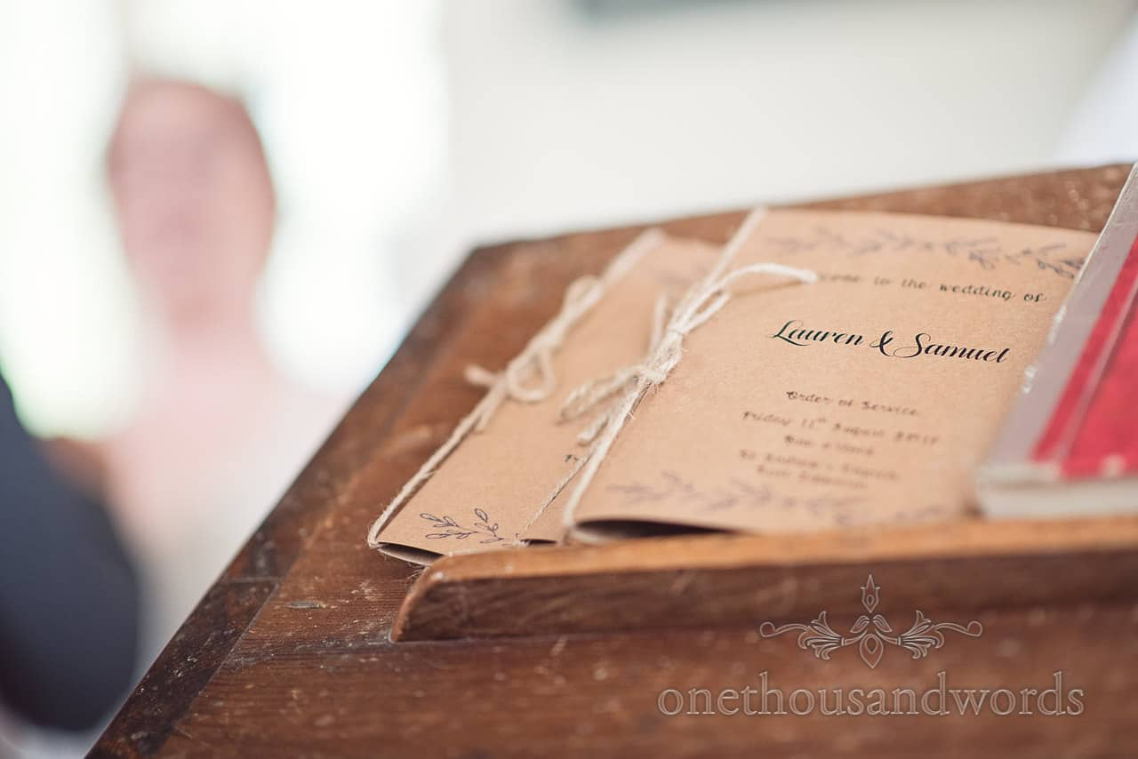 Hand made wedding booklet on pew at Lulworth Castle Wedding Photographs