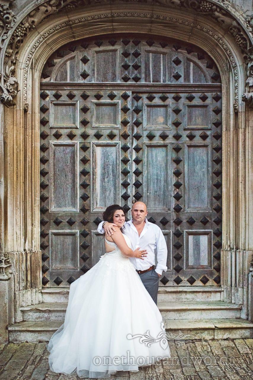 Highcliffe Castle Wedding Photographs of bride and groom with amazing doors