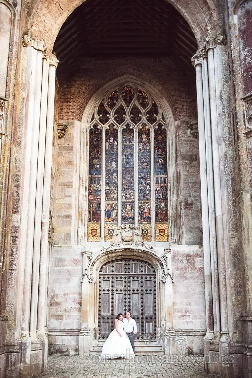 Highcliffe Castle Wedding Photographs of bride and groom with doors and stained glass