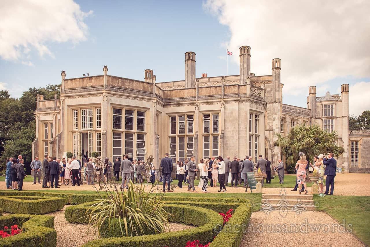 Highcliffe Castle Wedding Photographs of summer drinks reception in Dorset