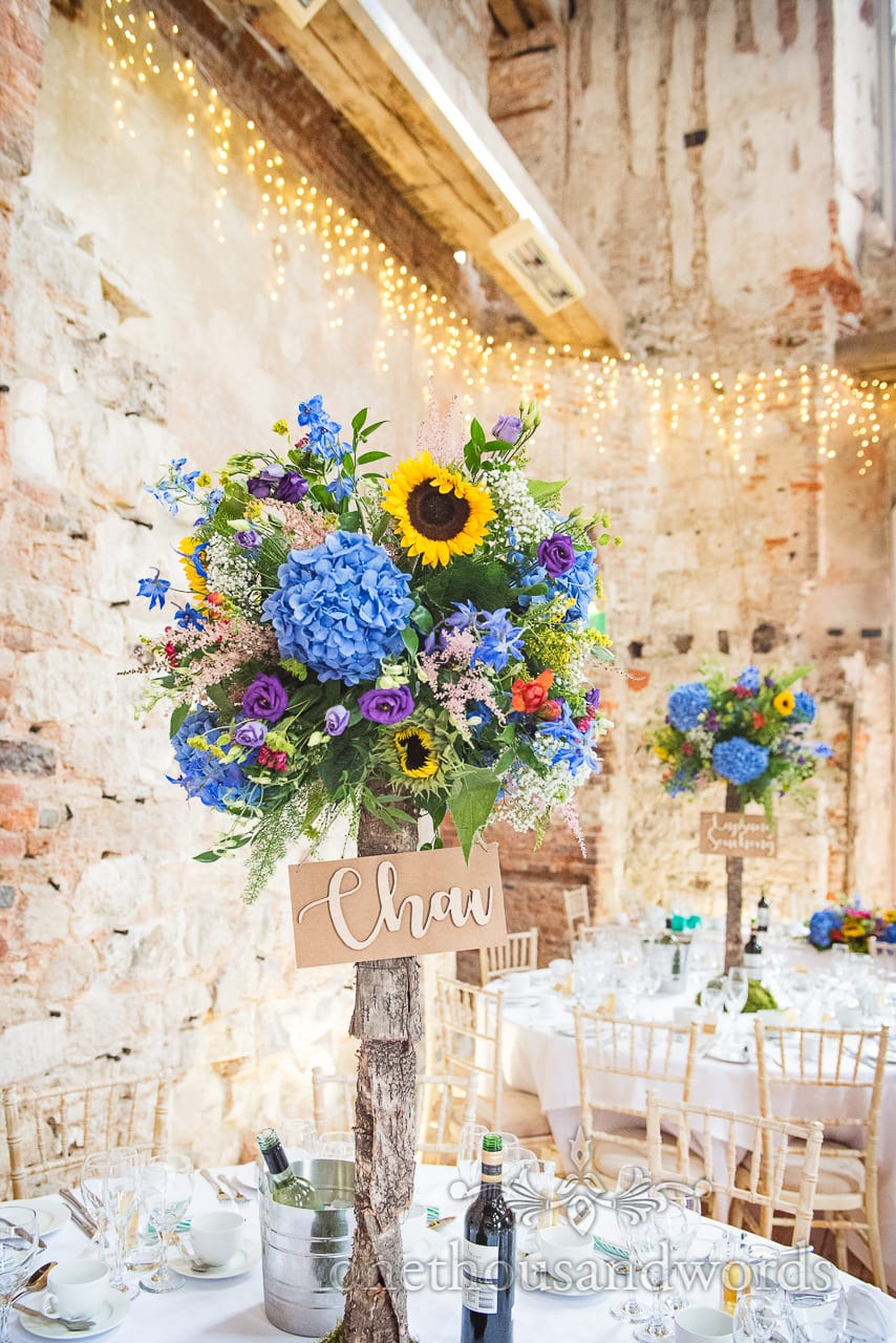 Incredible floral centerpieces at Lulworth Castle Wedding Photographs