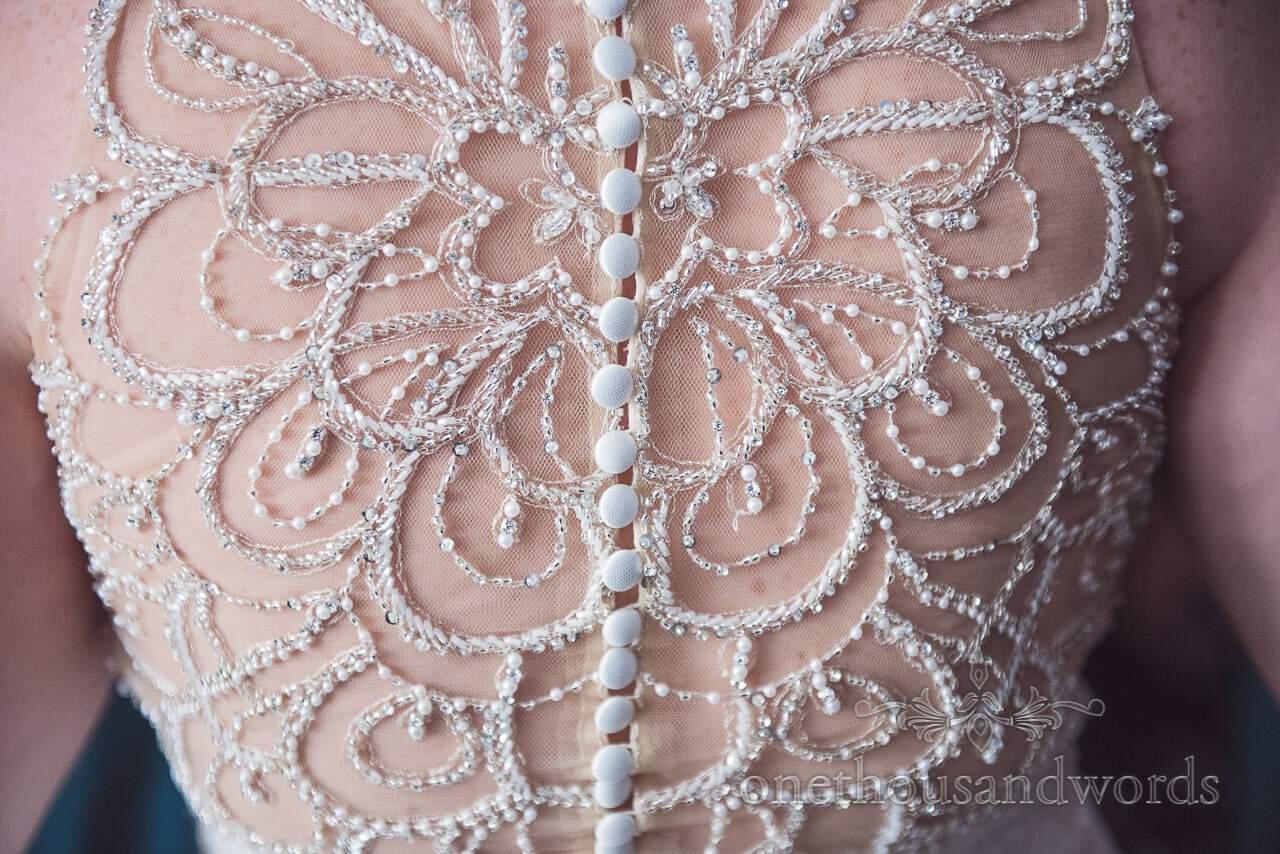 Intricate detailed back of wedding dress at Lulworth castle wedding