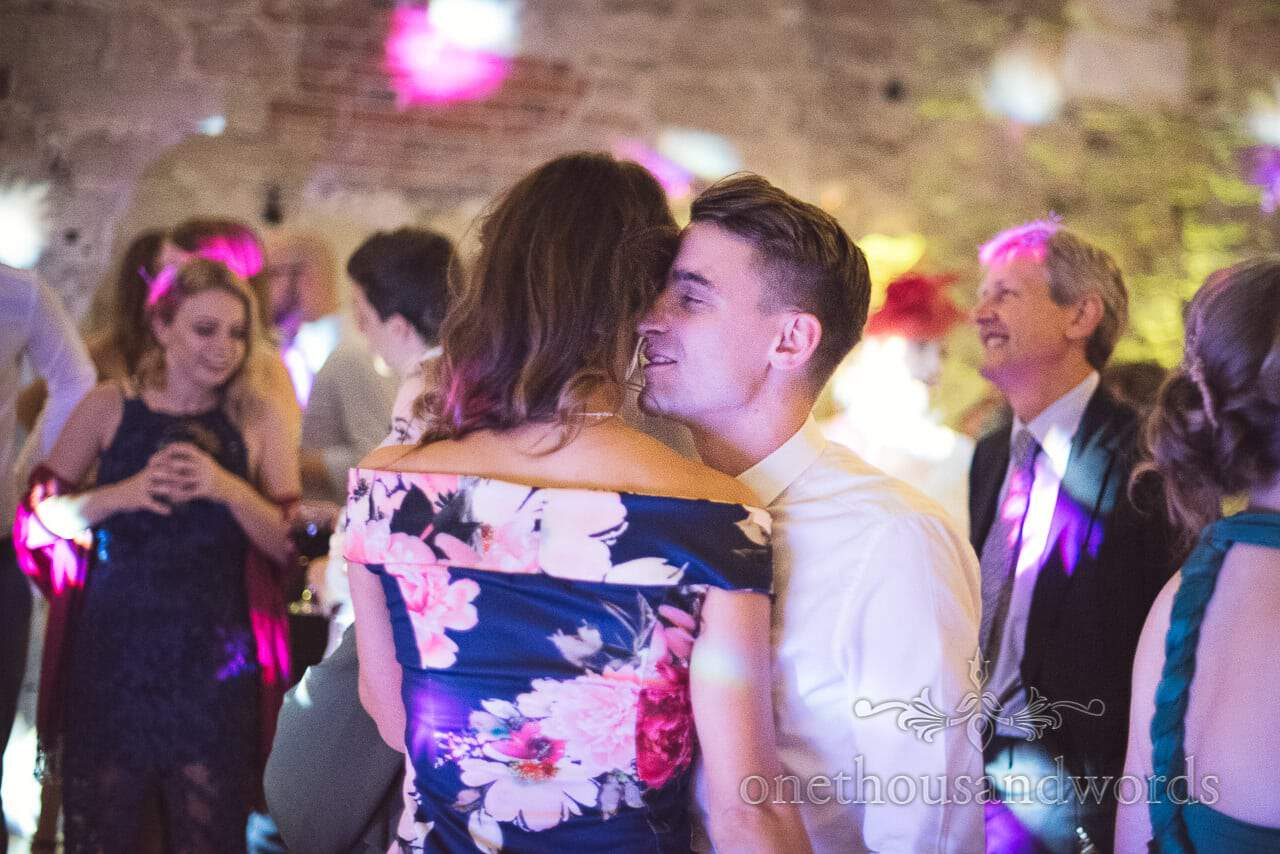 Lulworth Castle Wedding Photographs of guests dancing to wedding band