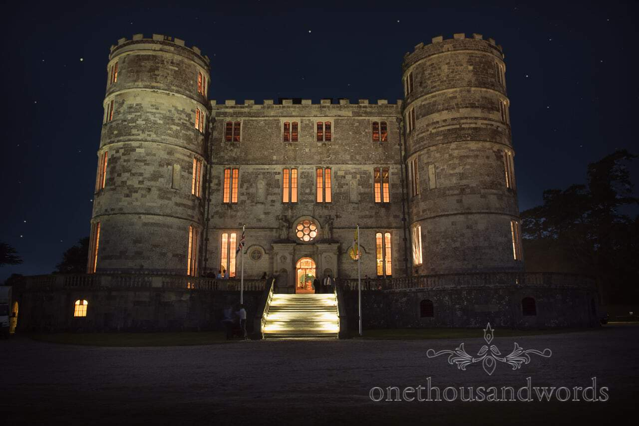 Lulworth Castle Wedding Venue in Dorset lit up at night with stars