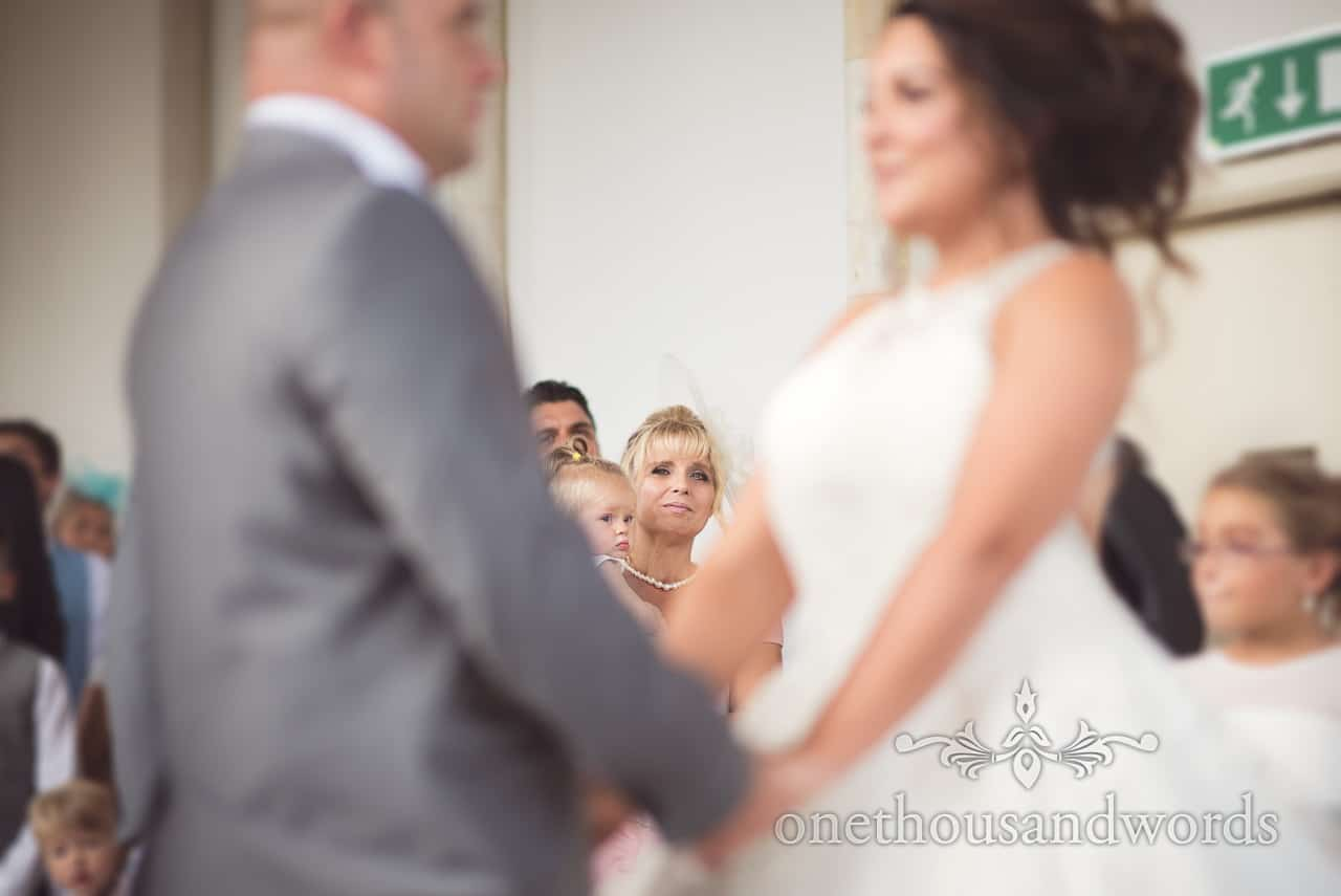 Mother of the bride watches marriage ceremony at Highcliffe Castle Wedding