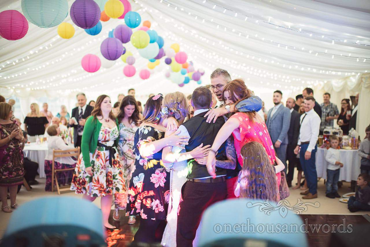 Newlywed mobbed by wedding guests at climax of first dance