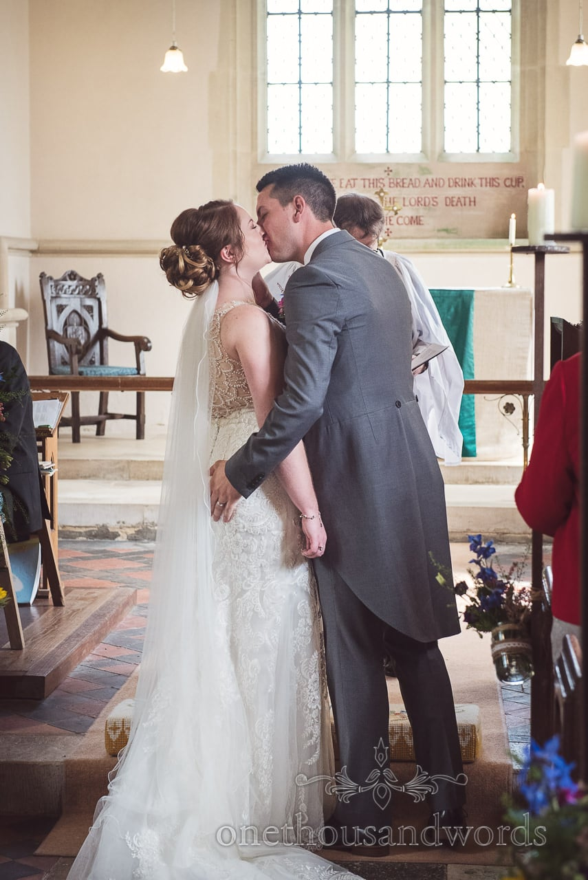 Newlyweds share first kiss at Lulworth Castle Wedding Photographs