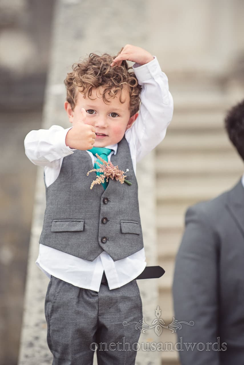Page boy gives it the thumbs up at Lulworth Castle Wedding Photographs