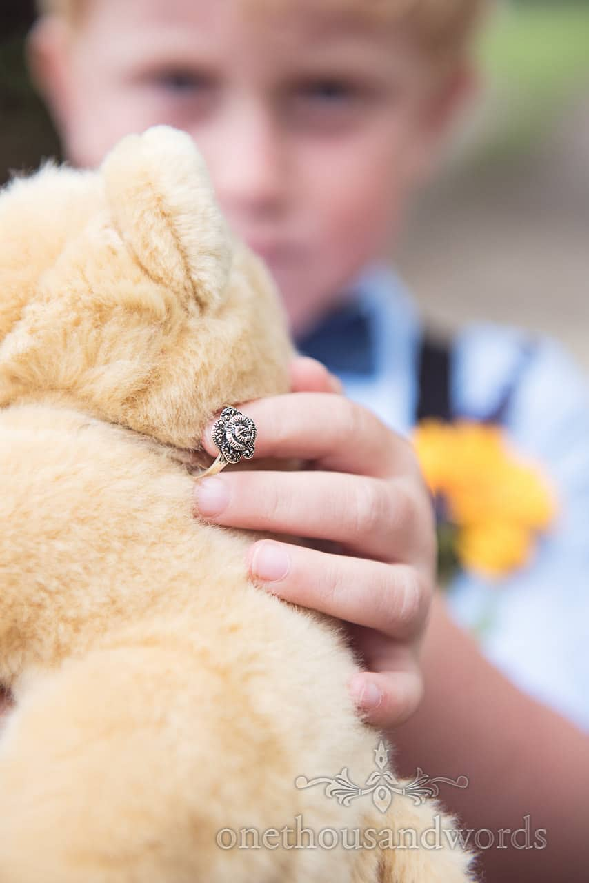 Page boy holds sot toy with wedding ring at Morten Gardens Wedding ceremony