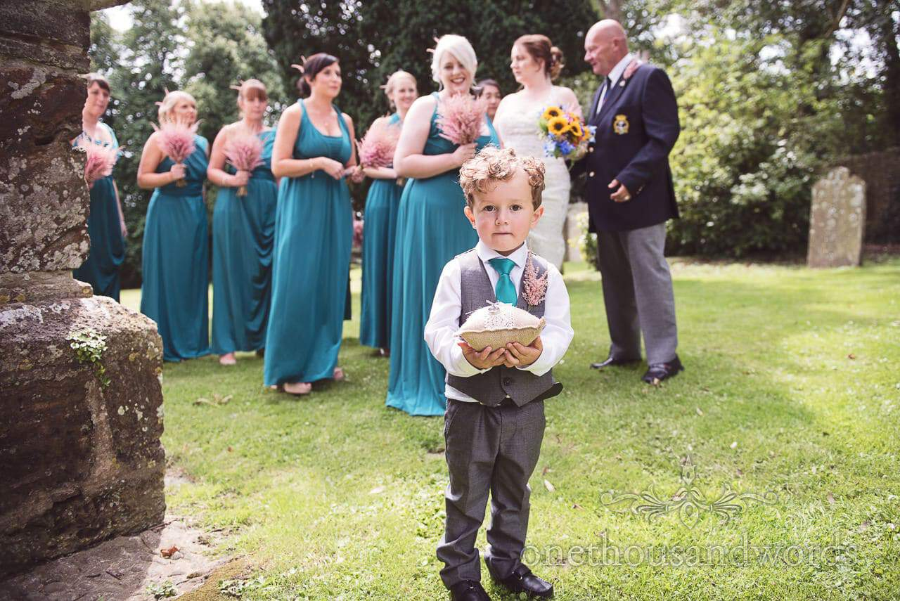 Page boy ring bearer with bridesmaids at Lulworth Castle Wedding Photographs