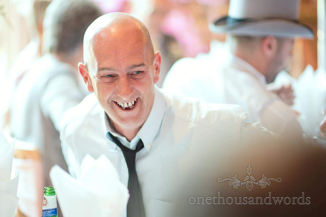 Portrait of wedding guest laughing at Highcliffe Castle Wedding breakfast