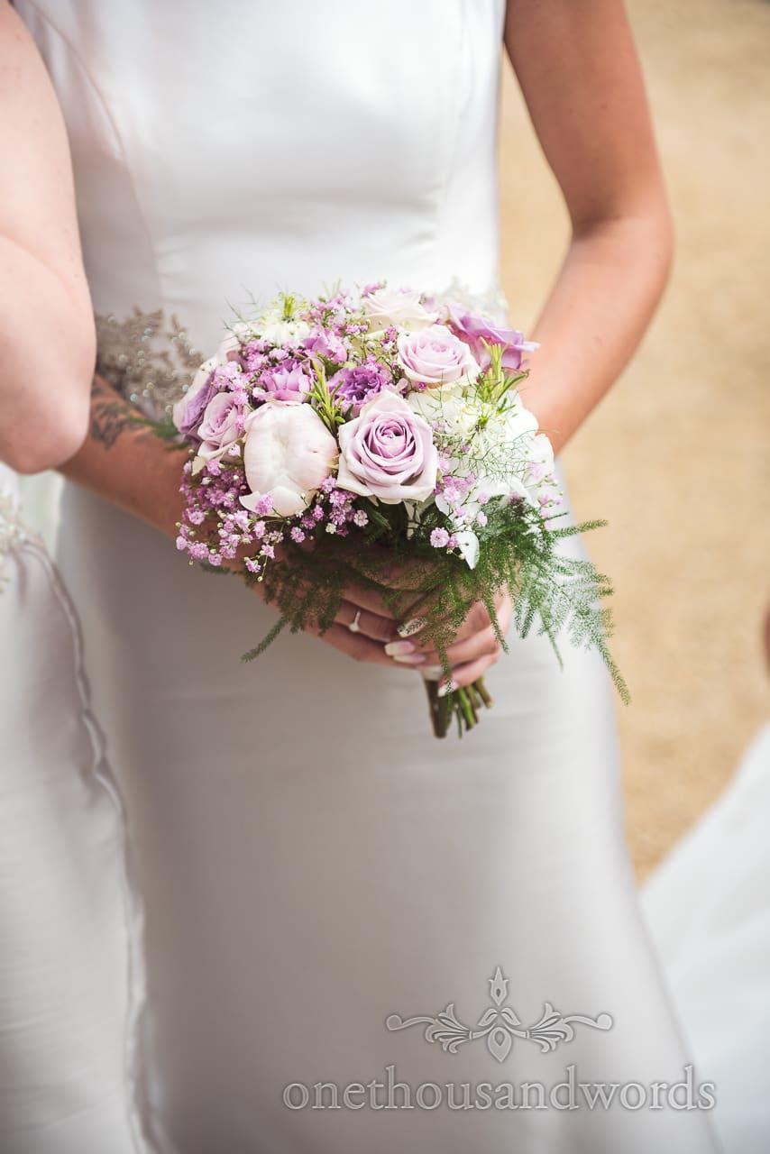Purple and white wedding flower bouquet at Highcliffe Castle Wedding