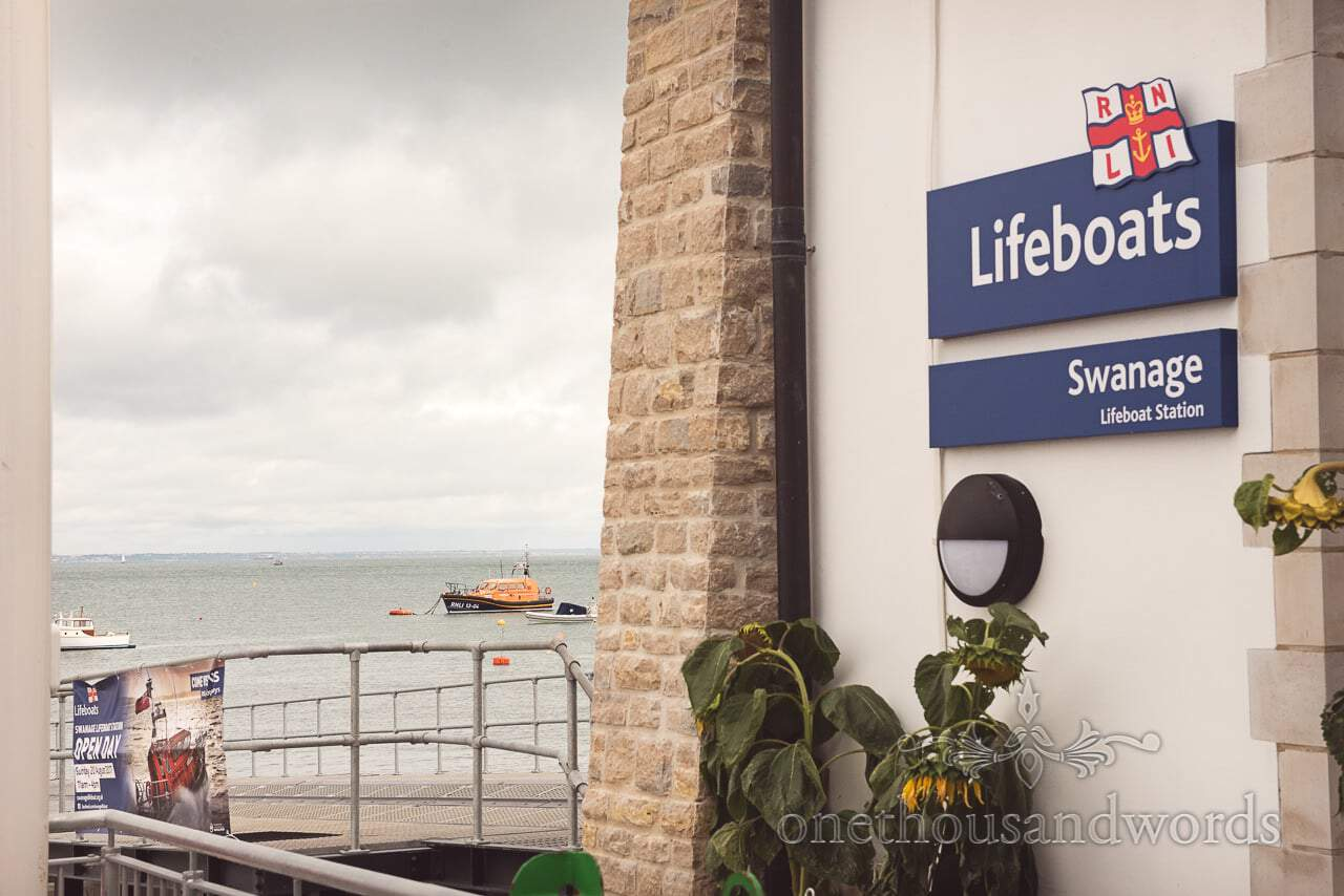 RNLI Swanage Lifeboat Station in Dorset with lifeboat moored in the sea