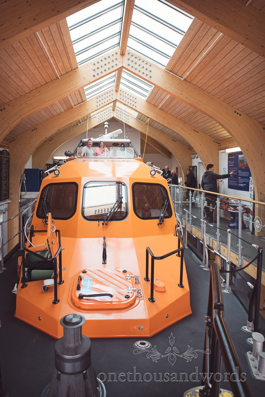 Swanage Lifeboat and Swanage lifeboat station with couple onboard during photo shoot