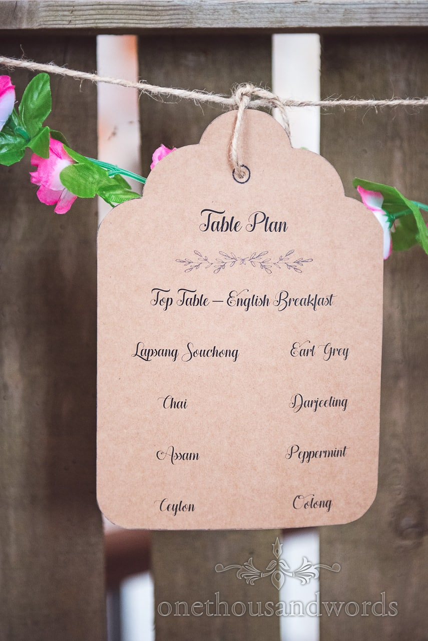 Tea inspired table plan at Lulworth Castle Wedding Photographs