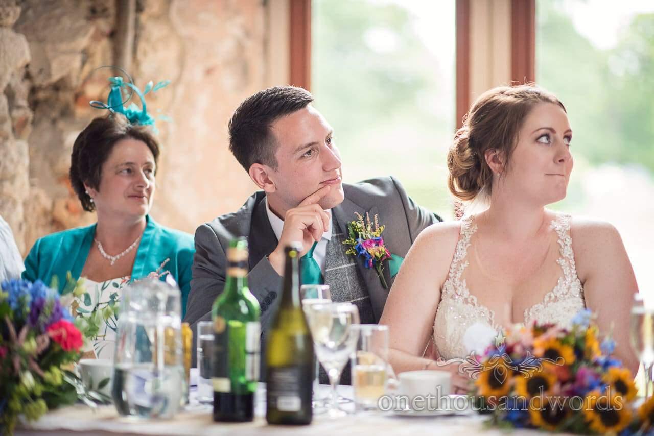 Top table listen to wedding speeches at Lulworth Castle Wedding breakfast