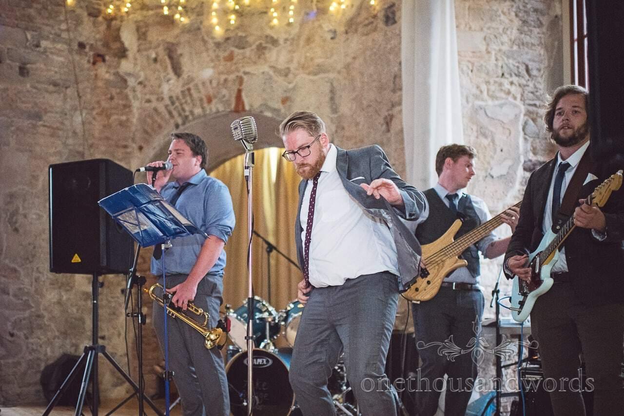 Wedding band singer dances at Lulworth Castle Wedding evening reception