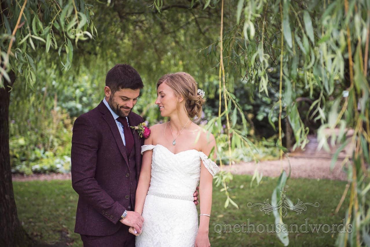 Wedding couple photograph under willow tree at Morten Gardens Wedding