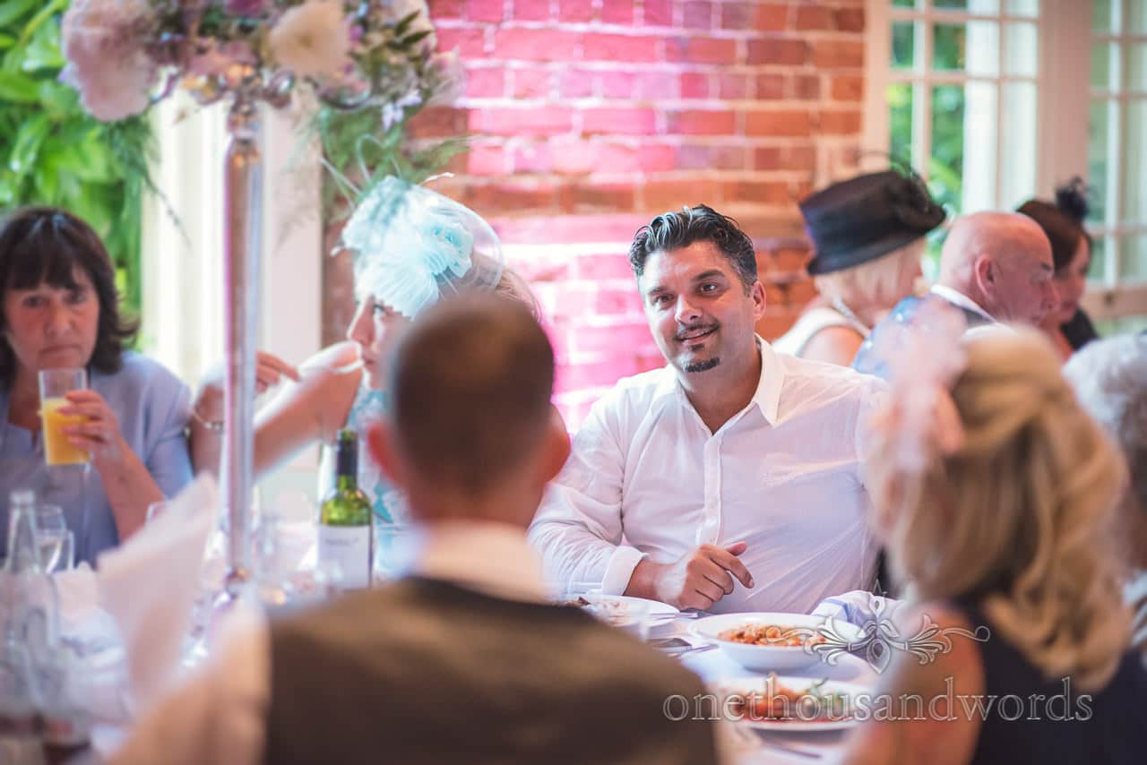Wedding guest during wedding breakfast at Highcliffe Castle Wedding