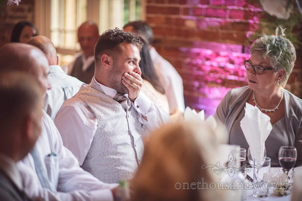 wedding guest laughs at joke during Highcliffe Castle Wedding breakfast