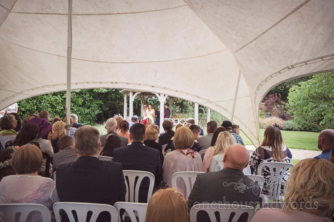 Wedding guest makes reading at Morten Walled Gardens Wedding ceremony