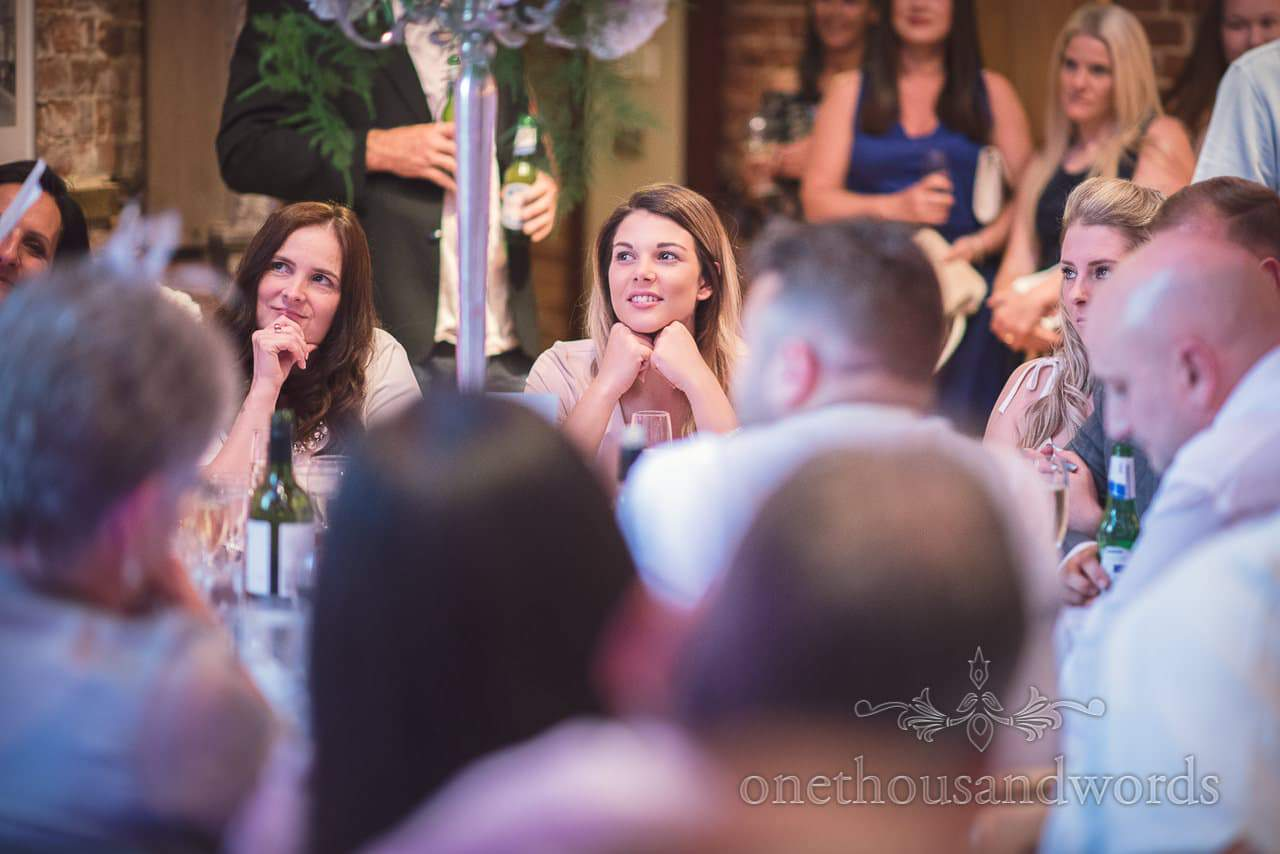 Wedding guests attentively listen to wedding speeches at Highcliffe Castle Wedding