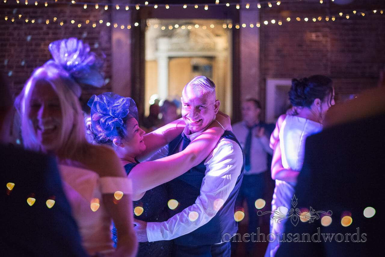 Wedding guests dancing at Highcliffe Castle Wedding evening reception