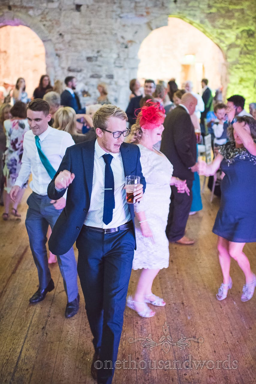Wedding guests dancing at Lulworth Castle Wedding evening reception