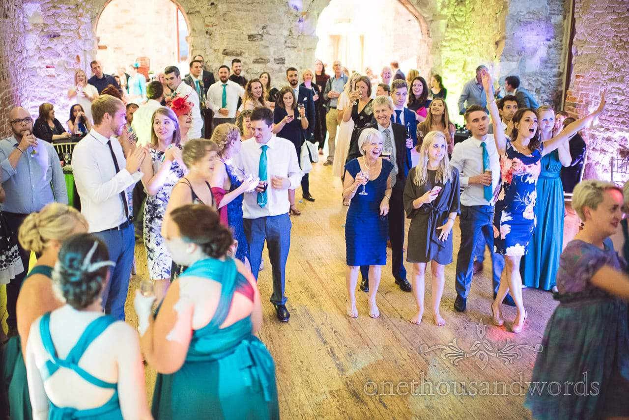 Wedding guests watching wedding band at Lulworth Castle Wedding Photographs