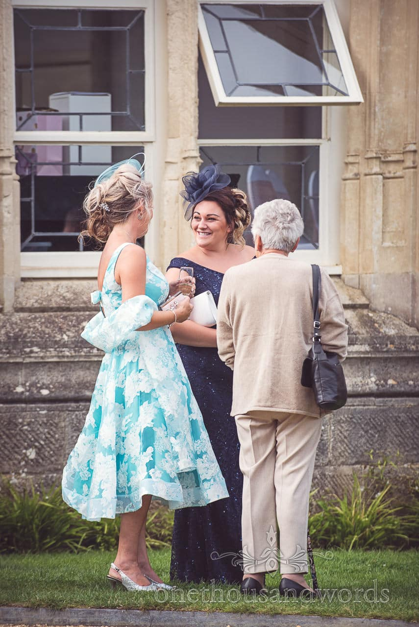 Wedding guests wear fascinators at Highcliffe Castle Wedding reception