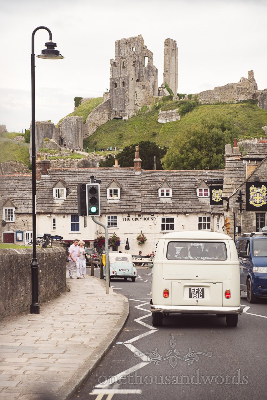 Wedding transport passes through Corfe Castle on way to Lulworth Castle Wedding Photographs