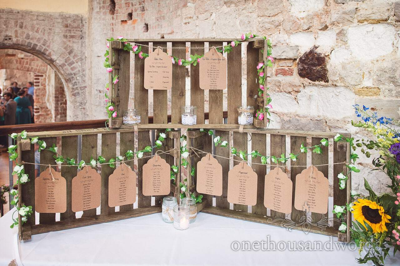 Wooden box and labels Tea table plan at Lulworth Castle Wedding Photographs