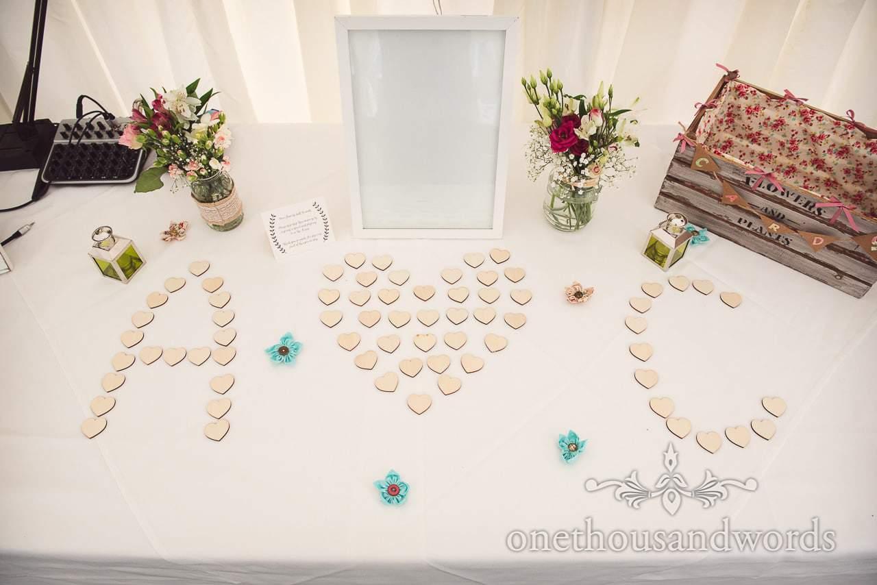 Arranged wooden heart inserts from signing frame at Coppleridge Inn Wedding Photographs