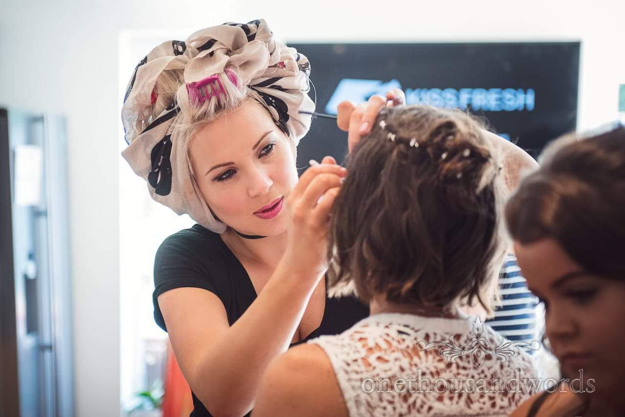 Beautiful wedding make up artist wears stylish head towel on wedding morning