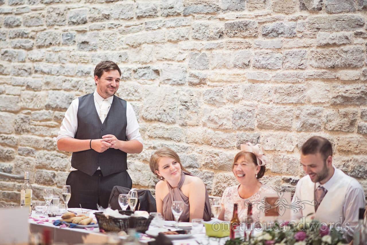 Best man announces wedding speeches at Durlston Castle Wedding Breakfast