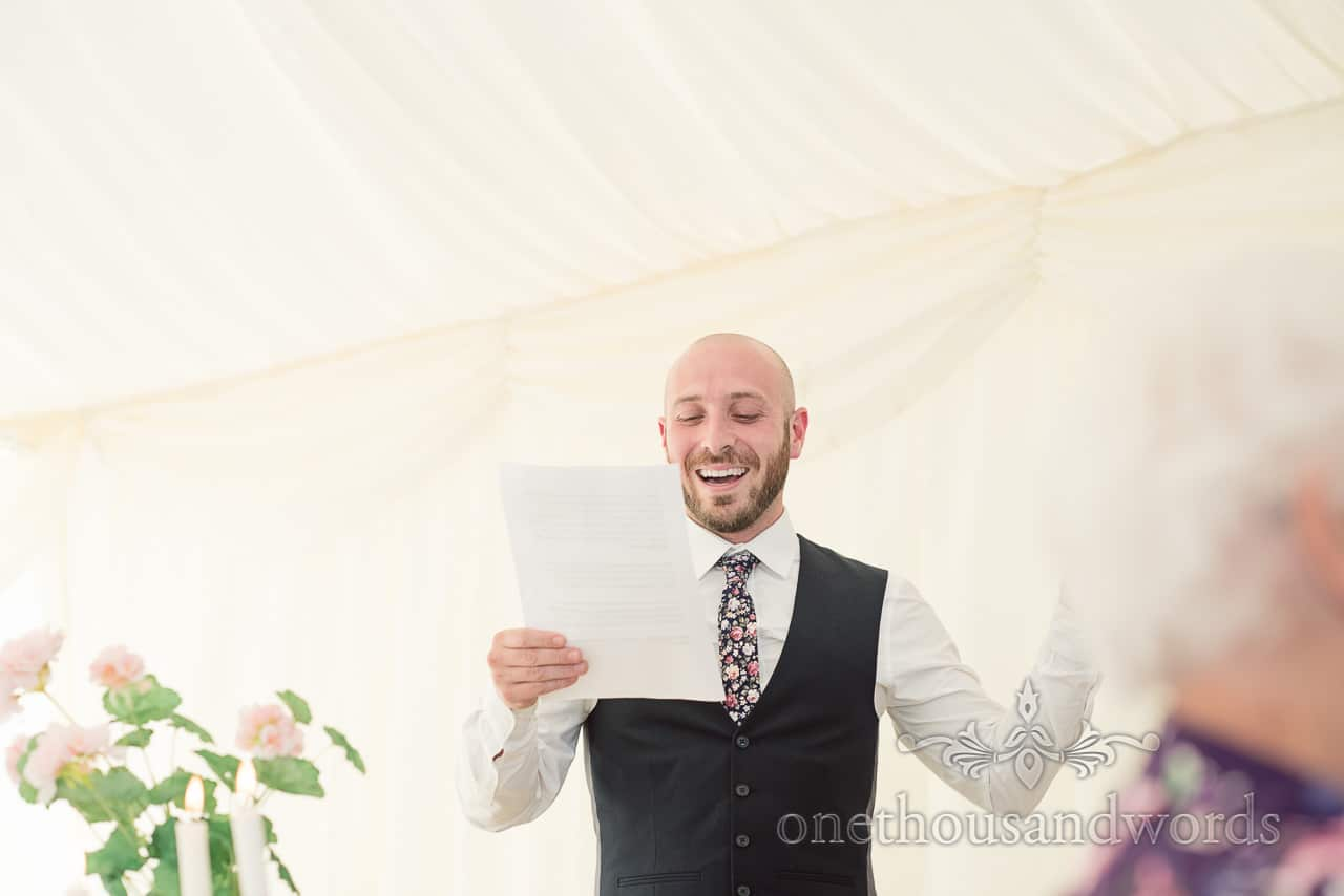 Best man delivers his speech at Purbeck Valley Farm wedding photographs