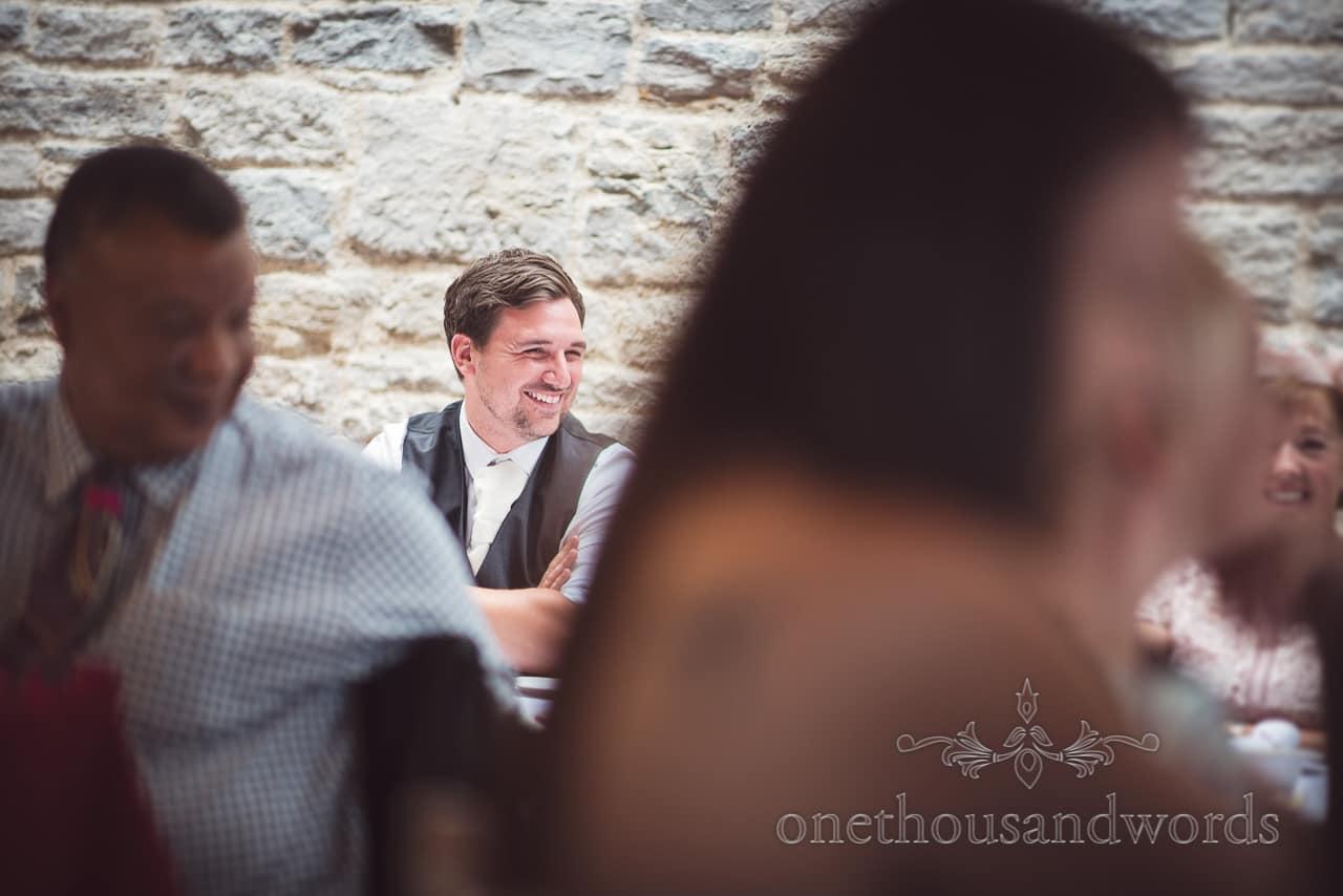 Best man laughs at wedding speeches at Durlston Castle Wedding venue in Dorset