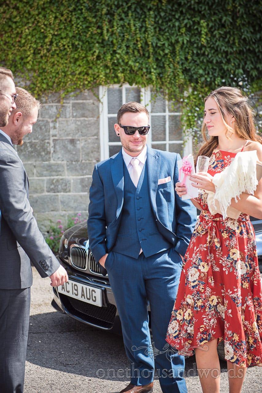 Best man with guests before Coppleridge Inn woodland Wedding