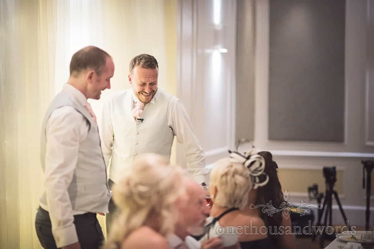 Best men laugh at jokes during wedding breakfast in Bournemouth Hotel