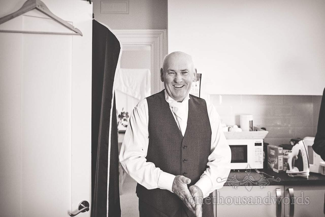 Black and white wedding photograph of father of the groom on wedding morning