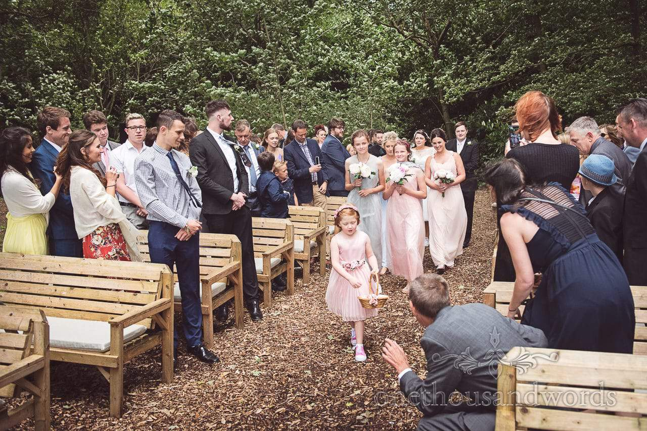 Bridal party come down the aisle at Coppleridge Inn woodland Wedding