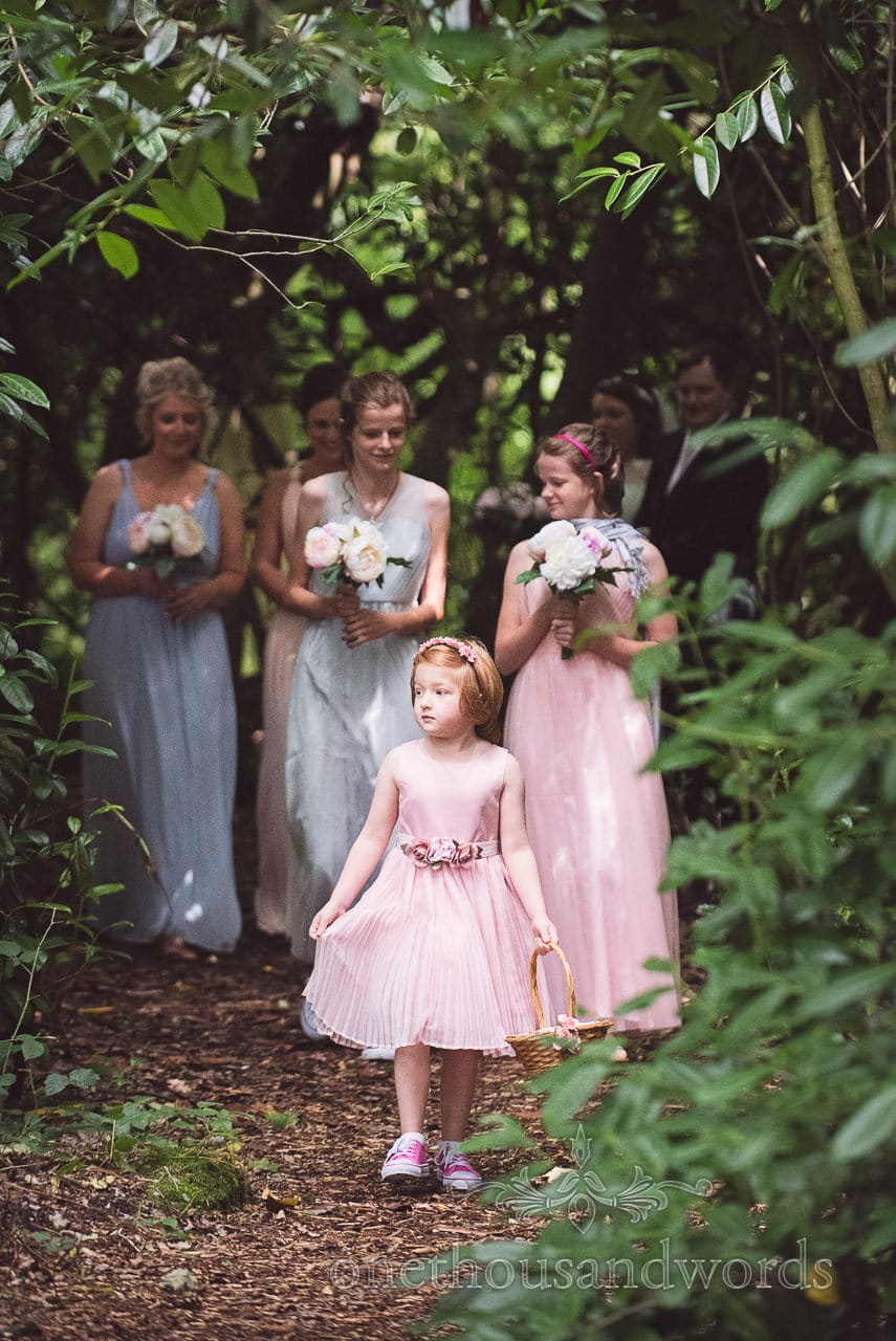 Bridal party enter ceremony space at Coppleridge Inn woodland wedding