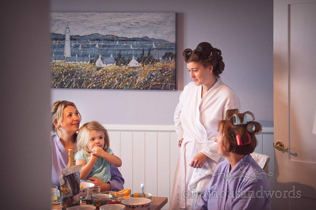Bridal party in hair curlers and dressing gowns on wedding morning in Dorset
