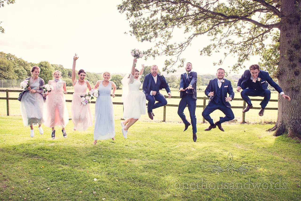 Bridal party jumping for joy at Coppleridge Inn Wedding Photographs