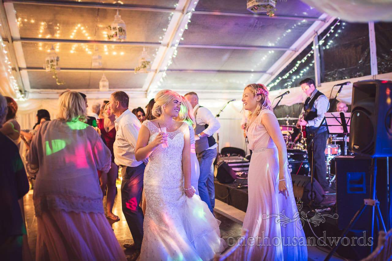 Bride and bridesmaid on the dance floor at Purbeck Valley Farm Wedding photographs