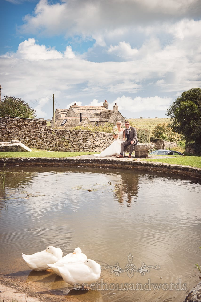 Bride and groom at duck pond in Worth Matravers
