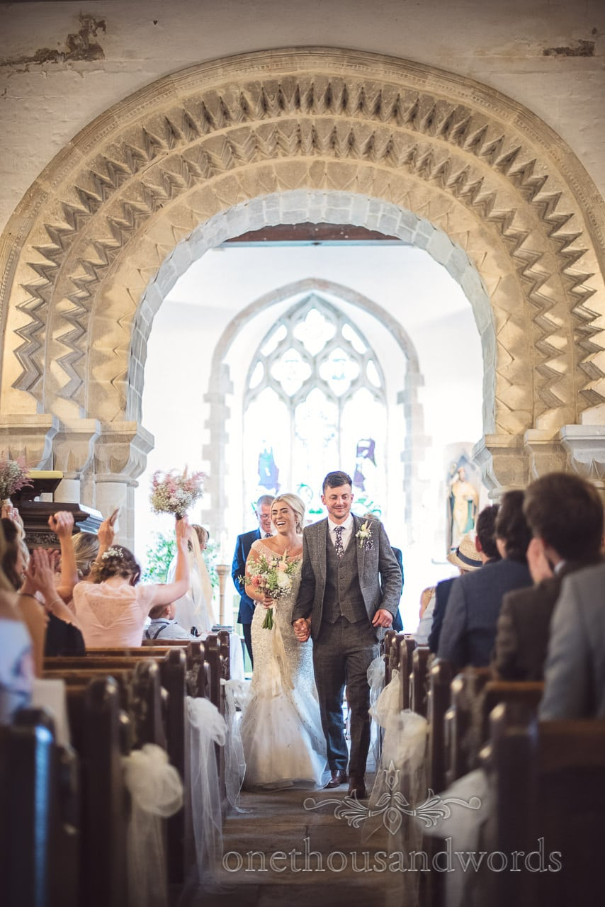 Bride and groom come down the aisle as husband and wife